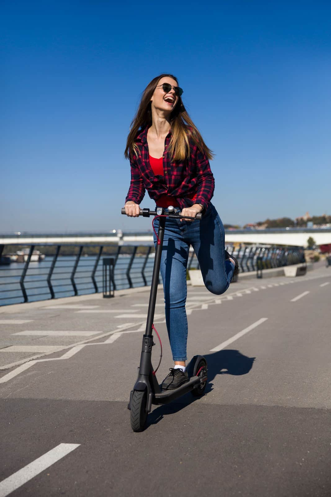 Best 5 Coolest Electric Scooters For Sale In 2020 Review - Smiling Riding on Electric Scooter